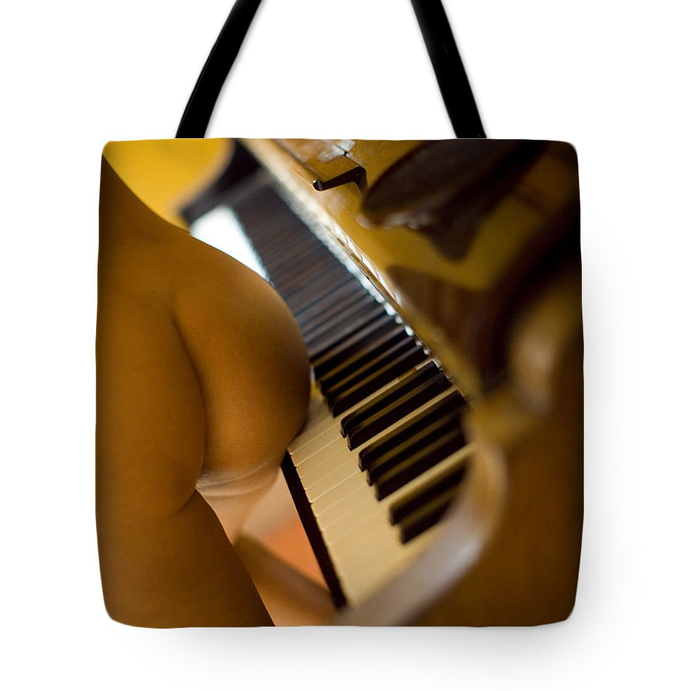 Sensual Tote Bag featuring the photograph The Piano by Olivier De Rycke