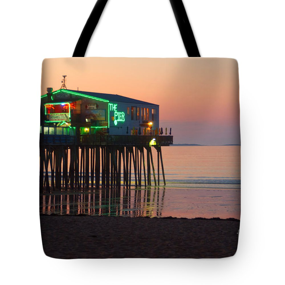 Pier Tote Bag featuring the photograph The Pier by Ray Konopaske