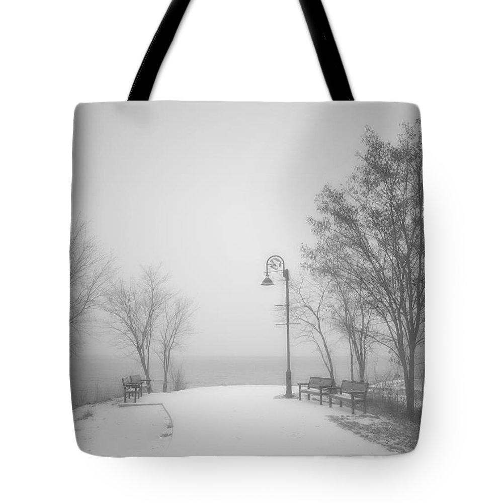 Black&white Tote Bag featuring the photograph The Quiet Moment Before Snow Touches Ground by Tara Turner