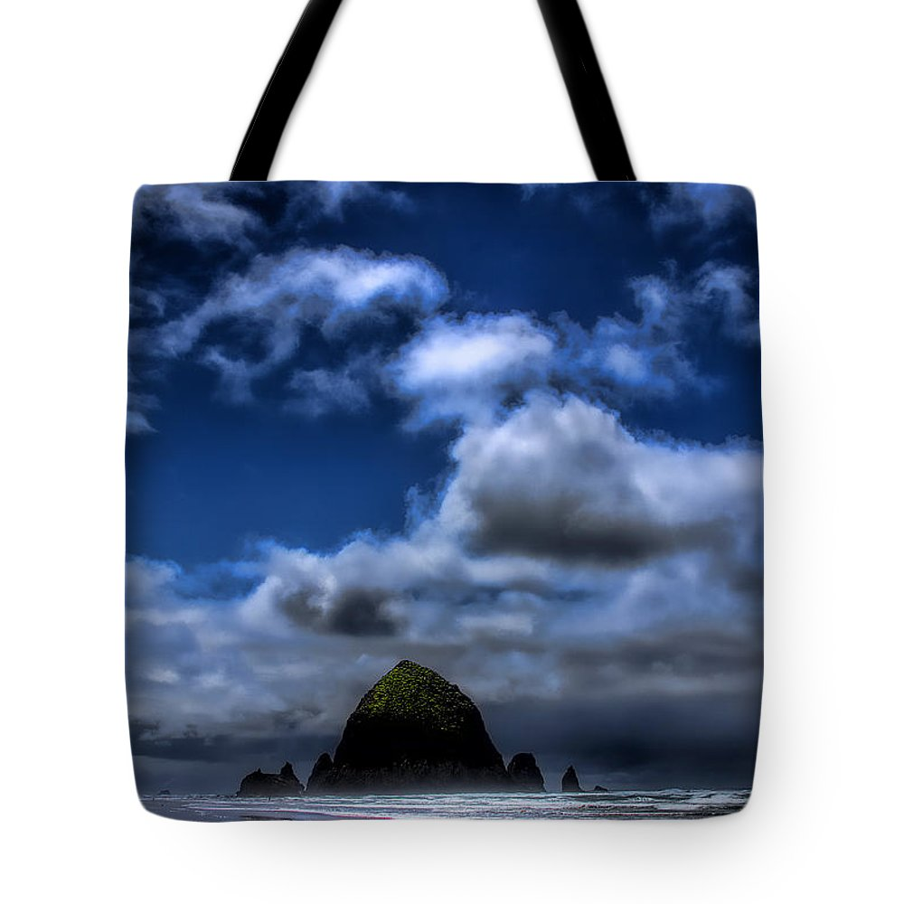 Cannon Beach Tote Bag featuring the photograph The Rock by David Patterson