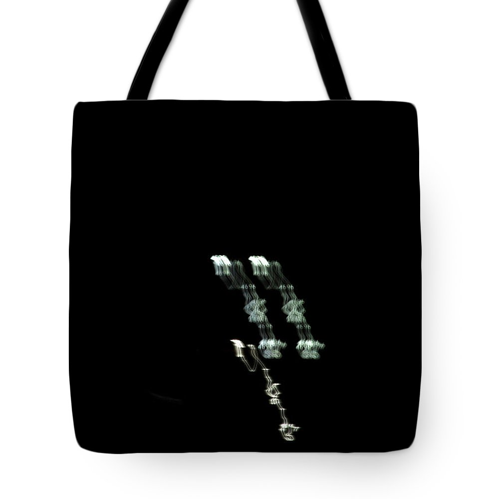 Abstract Tote Bag featuring the photograph The Skulls by Nicholas Haddox