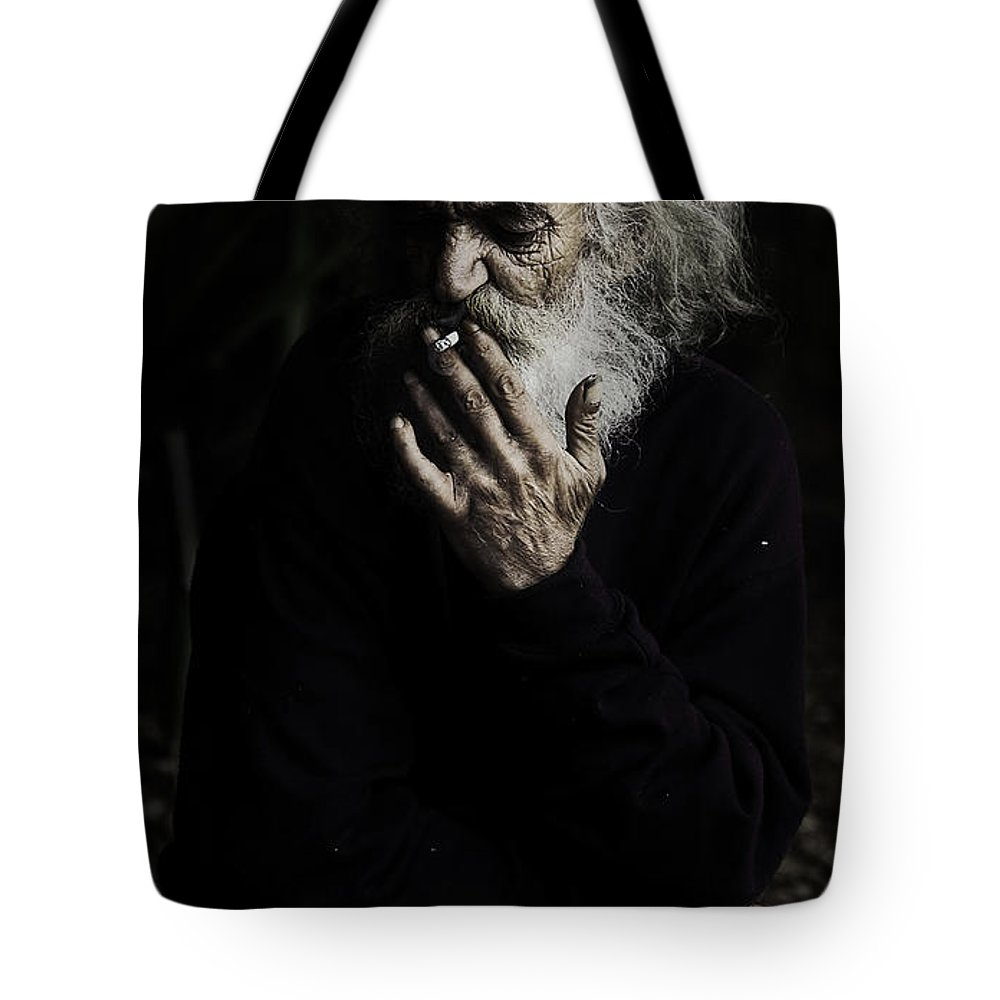 Homeless Male Smoking Smoker Aged Tote Bag featuring the photograph The Smoker by Sheila Smart Fine Art Photography