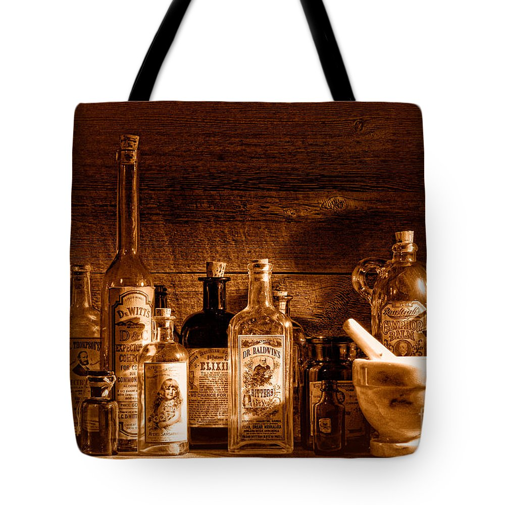 Apothecary Tote Bag featuring the photograph The Snake Oil Shop - Sepia by Olivier Le Queinec