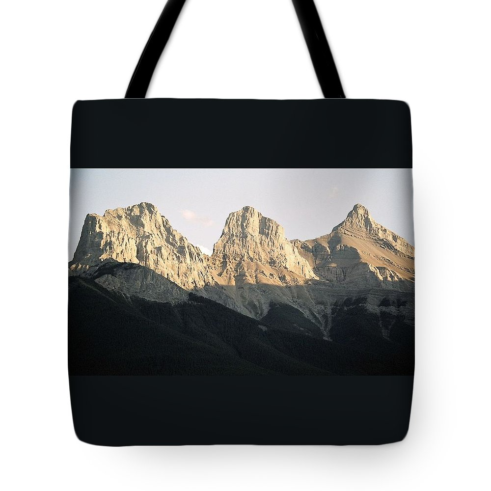 Rocky Mountains Tote Bag featuring the photograph The Three Sisters Of The Rockies by Tiffany Vest