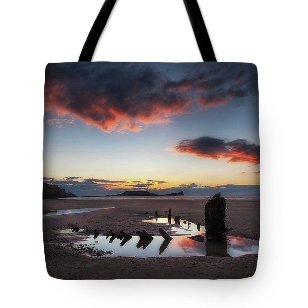 Rhossili Bay Tote Bag featuring the photograph The Wreck Of The Helvetia And Worms Head by Leighton Collins