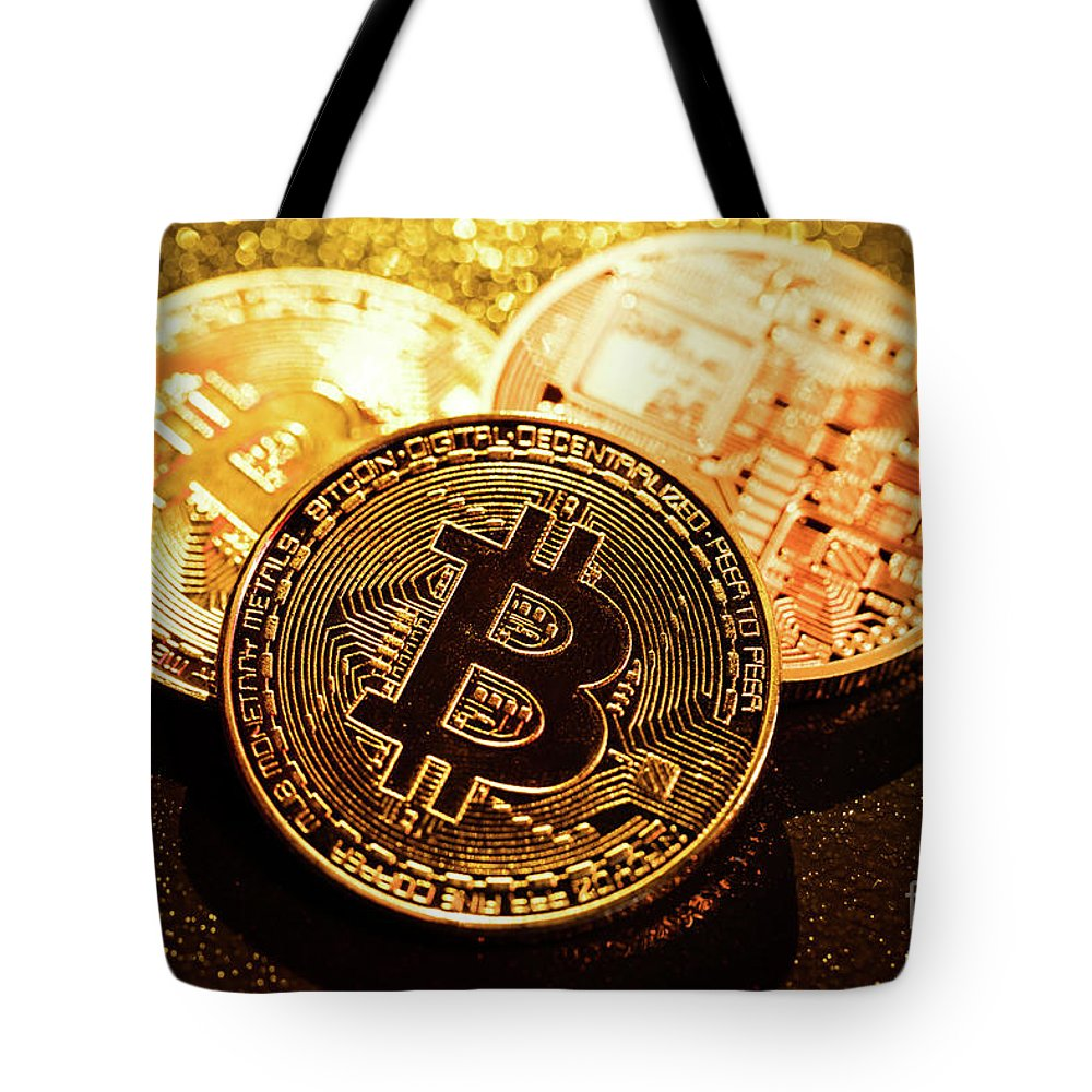 Bitcoin Tote Bag featuring the photograph Three Golden Bitcoin Coins On Black Background. by Michal Bednarek