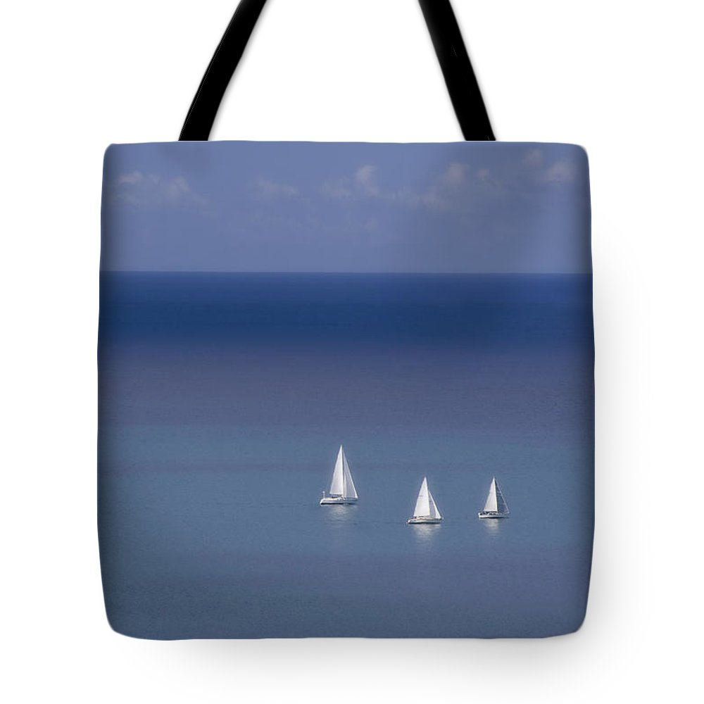 Blindpoet Tote Bag featuring the photograph Three Ships by Graham Hughes
