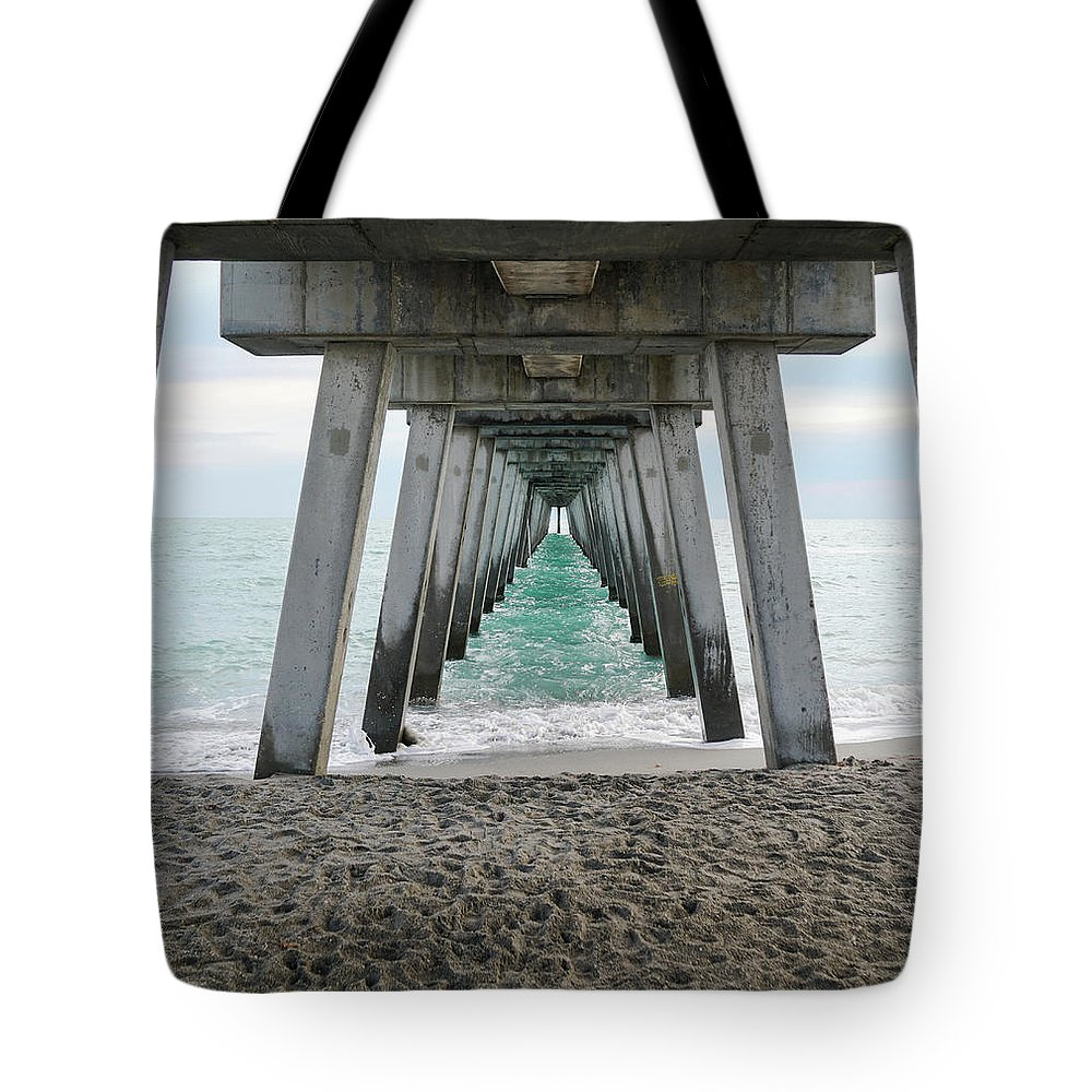 Pier Tote Bag featuring the photograph Through The Legs by Ric Schafer
