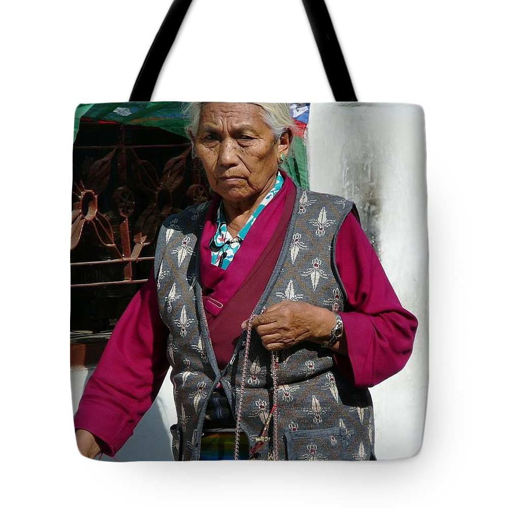 Prayer Tote Bag featuring the photograph Tibetan Grandmother In Meditation by Dagmar Batyahav