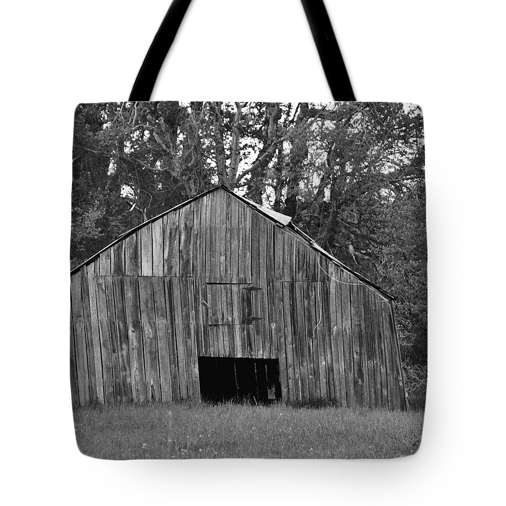 Barn Tote Bag featuring the photograph Tilting by Eric Liller
