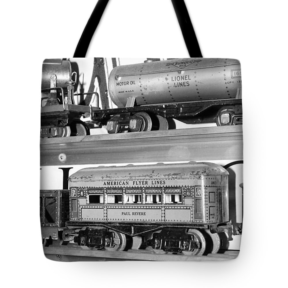 Lionel Tote Bag featuring the photograph Tin Toy Trains by Carmine Taverna