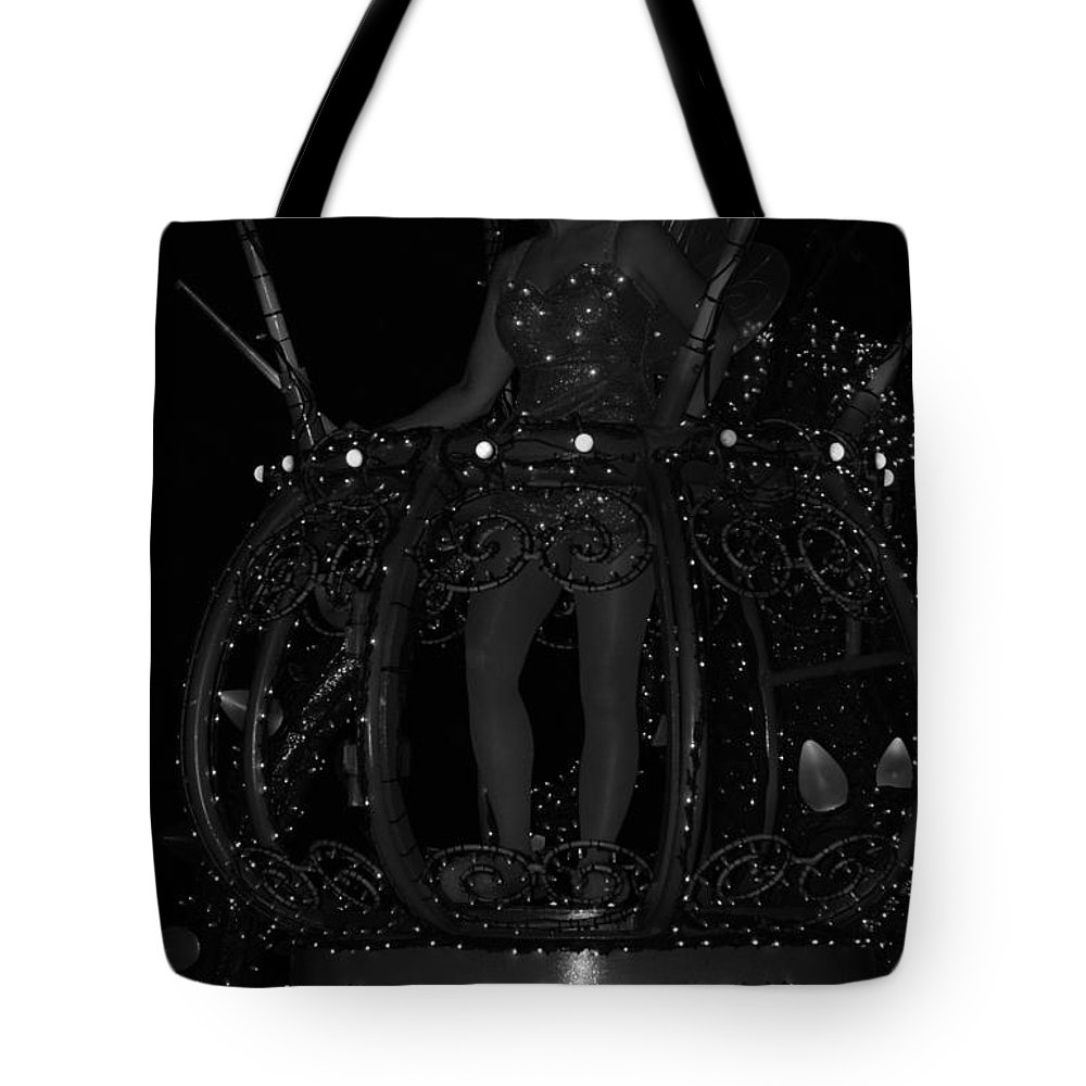 Walt Disney World Tote Bag featuring the photograph Tinker Bell by Rob Hans
