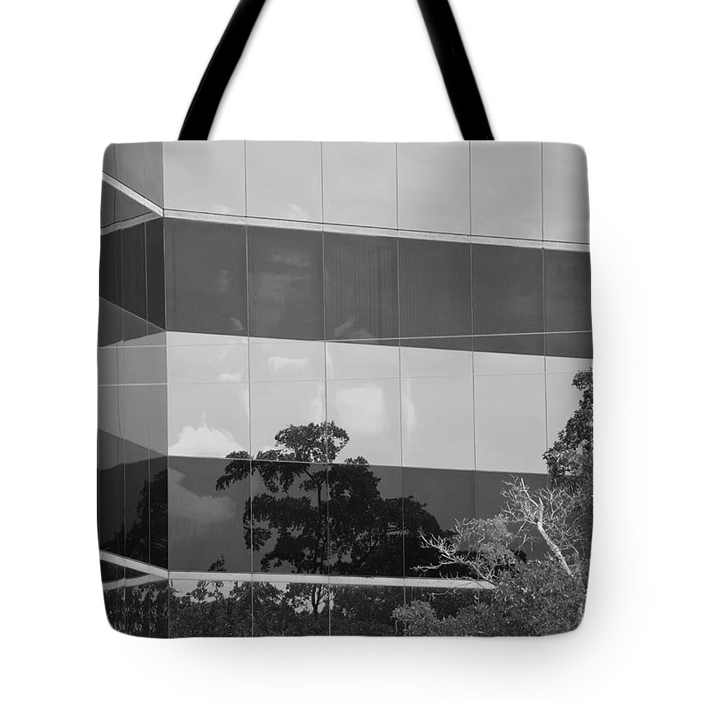 Black And White Tote Bag featuring the photograph Tinted Glass by Rob Hans