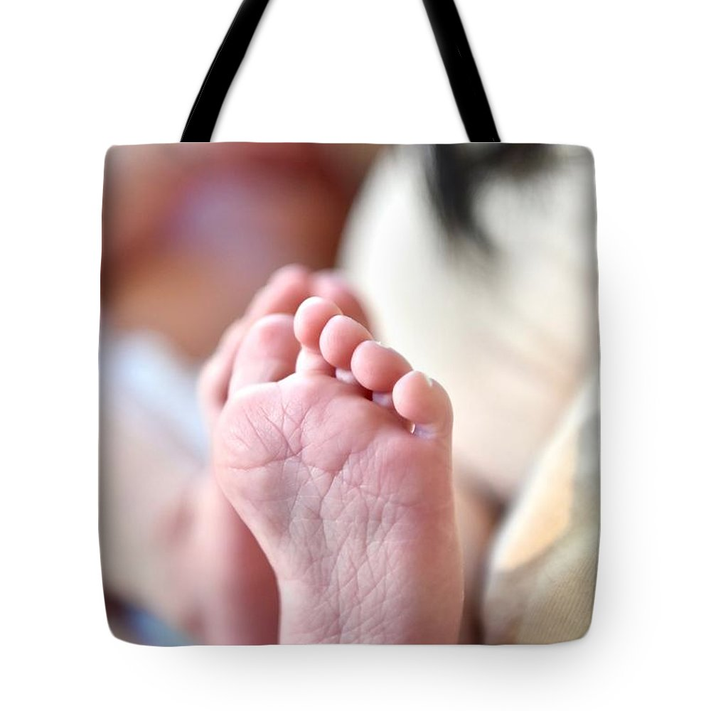 Babies Feet Tote Bag featuring the photograph Tiny Feet by Jeramey Lende