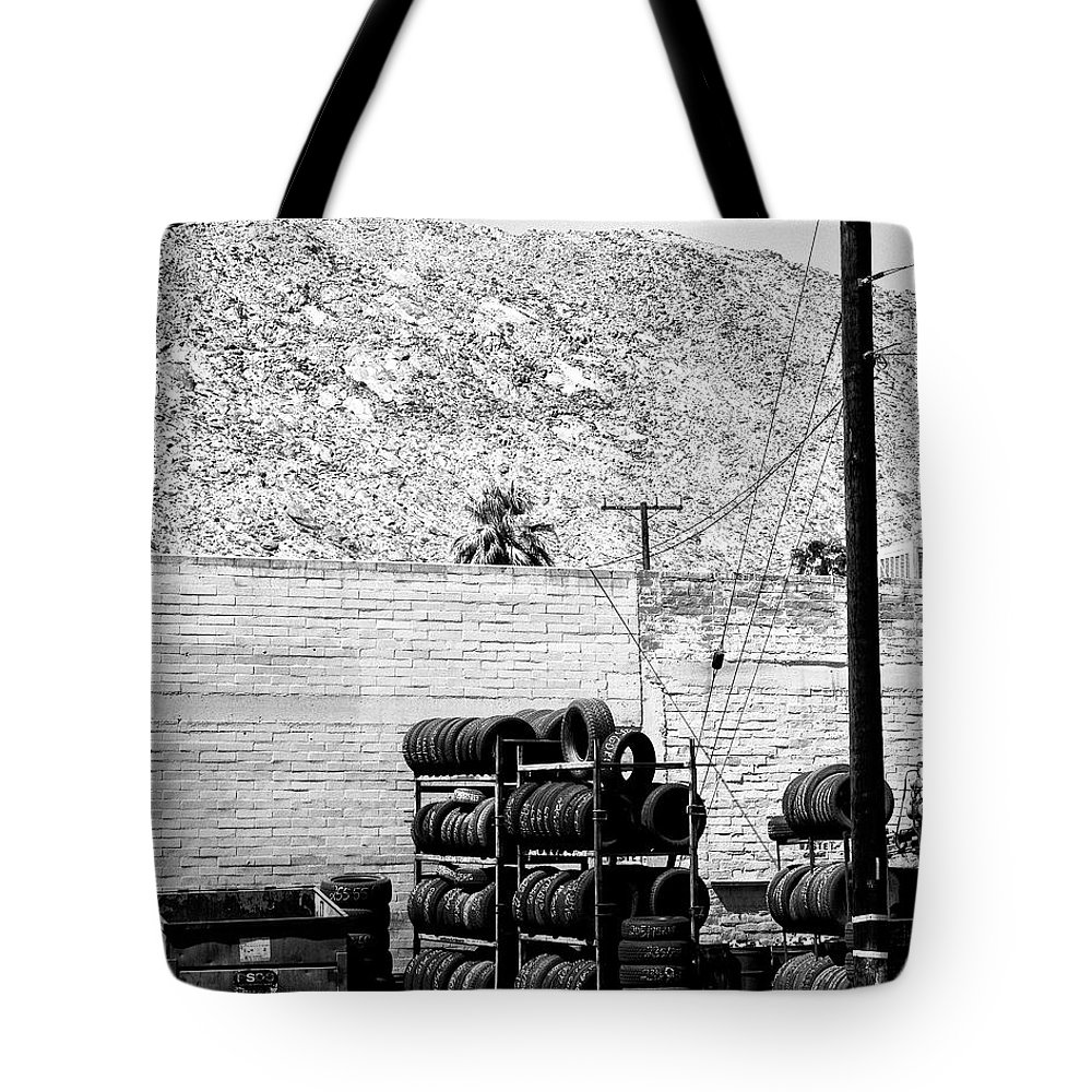 Industrial Desert Tote Bag featuring the photograph Tire Center by William Dey