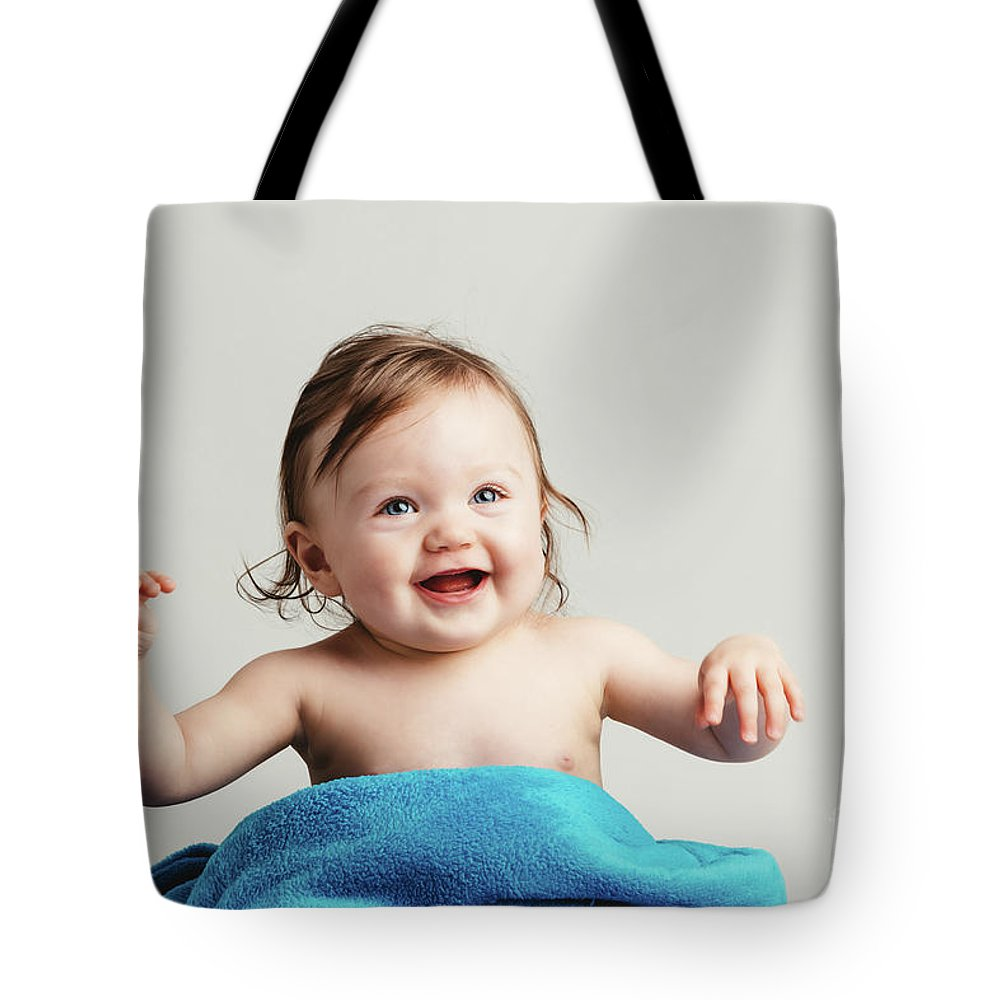Baby Tote Bag featuring the photograph Toddler With A Cozy Blanket Sitting And Smiling. by Michal Bednarek