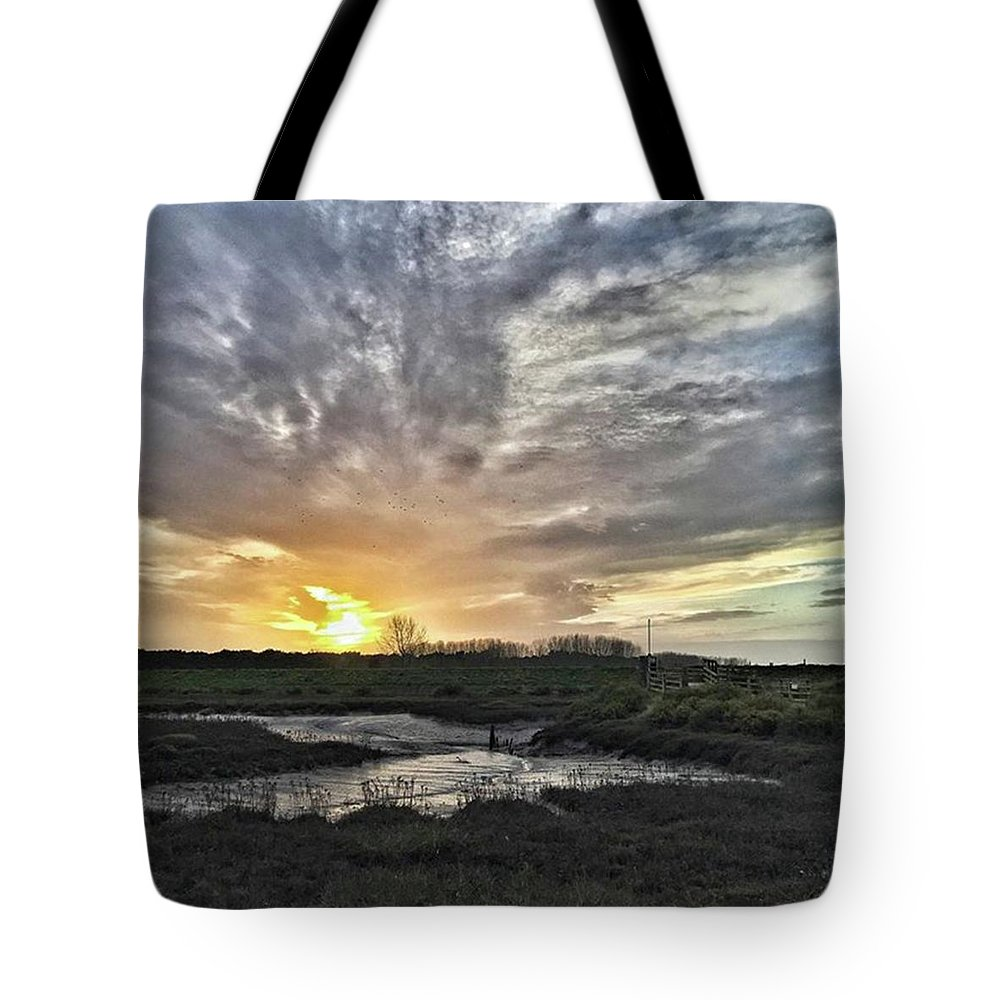 Natureonly Tote Bag featuring the photograph Tonight's Sunset From Thornham by John Edwards