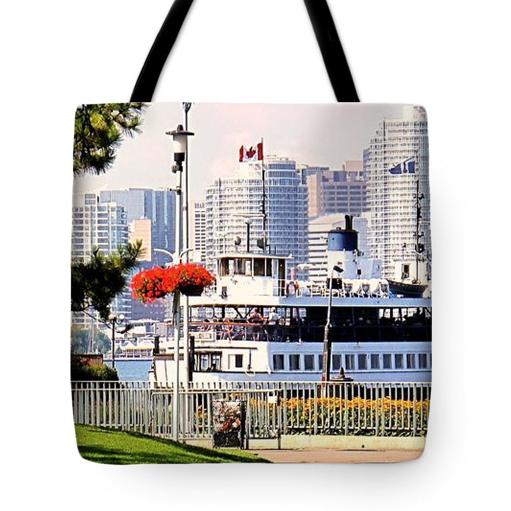 Toronto Tote Bag featuring the photograph Toronto Island Ferry Arrives by Ian MacDonald