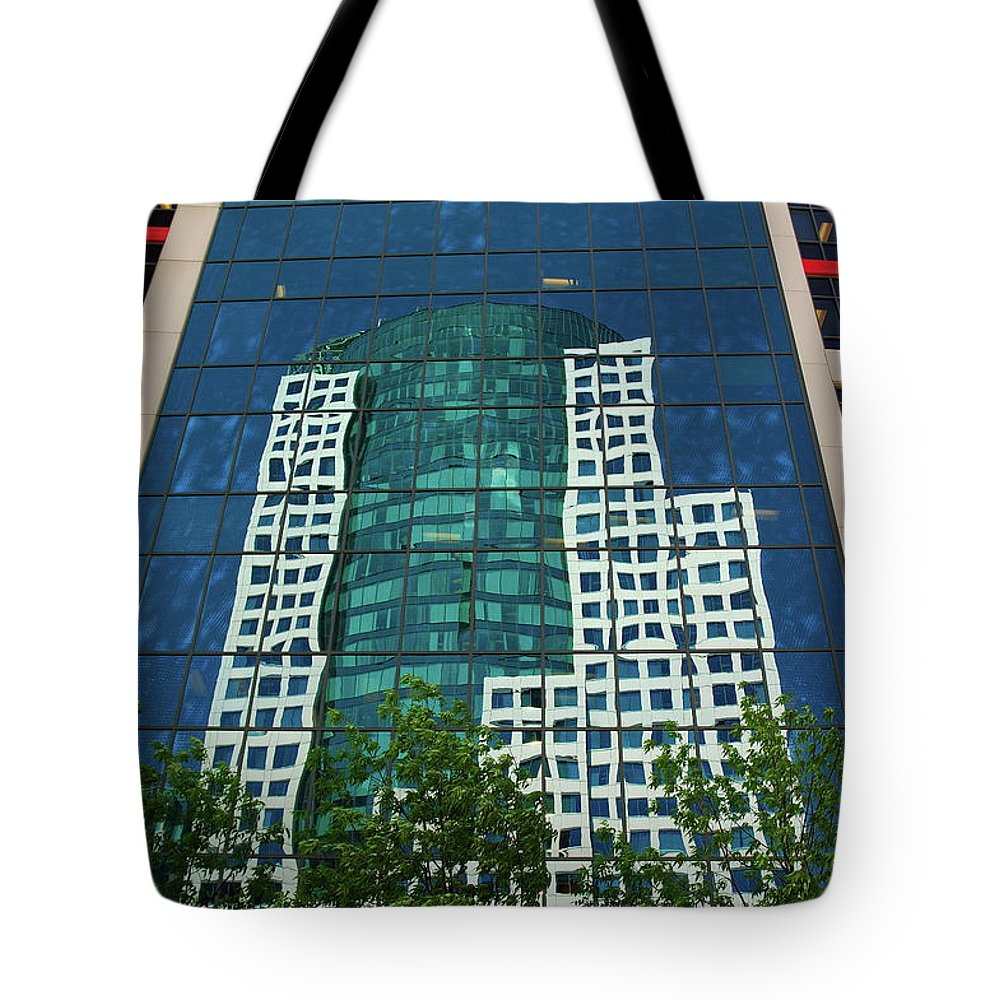 Cbc Toronto Reflection Tote Bag featuring the photograph Toronto Metro Hall Reflected In The Cbc Building by Reimar Gaertner