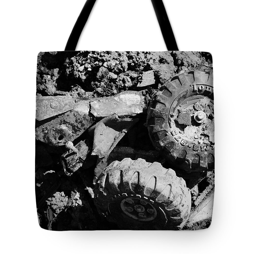 Toy Tote Bag featuring the photograph Tossed Toy by Angus Hooper Iii