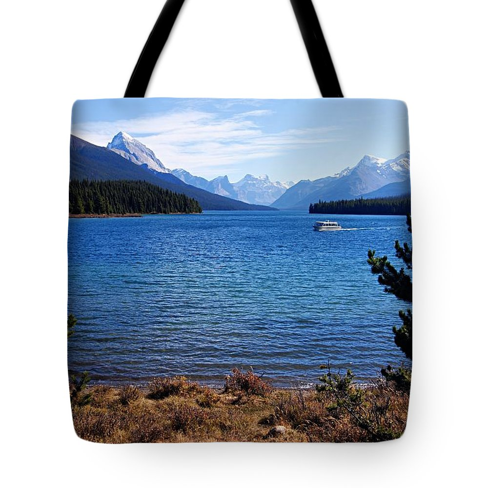 Maligne Lake Tote Bag featuring the photograph Touring Maligne Lake by Larry Ricker