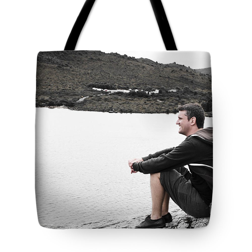 Man Tote Bag featuring the photograph Tourist Seated At Dove Lake Lookout In Tasmania by Jorgo Photography - Wall Art Gallery