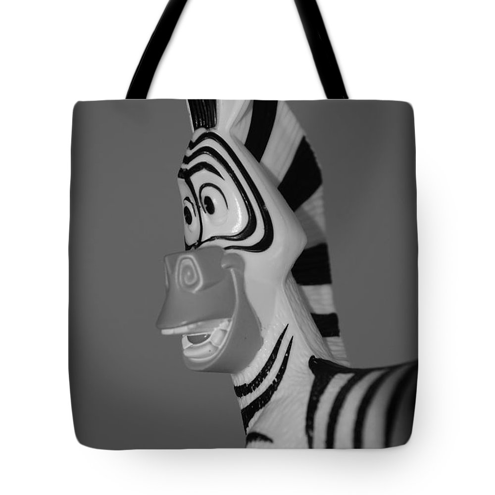 Black And White Tote Bag featuring the photograph Toy Zebra by Rob Hans