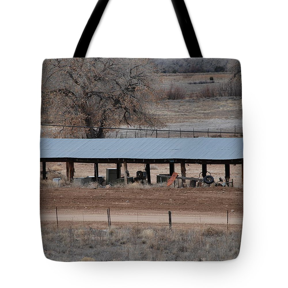 Architecture Tote Bag featuring the photograph Tractor Port On The Ranch by Rob Hans