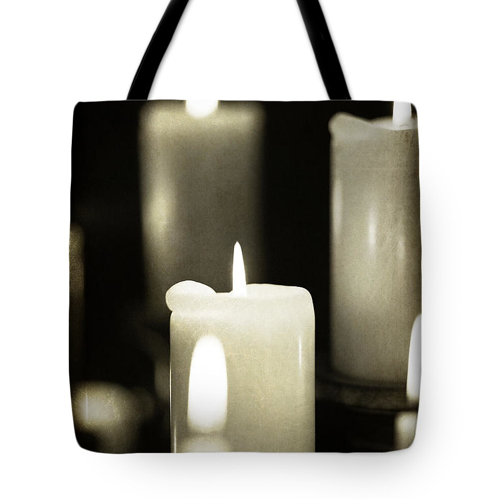 Atmospheric; Calm; Christianity; Demon; Erotic; Eternal; Evil; Magic; Mysterious; Mystery; Opulence; Romantic; Supernatural; Symbolic; Candles; Church; Flame; Altar; Home; Spooky; Spirituality; Meditation; Wax; Traditional; Tranquil; Candlelight; Bright; Burning; Illuminated; Glowing; Glow; Decoration Tote Bag featuring the photograph Tranquility by Jacqui Hall