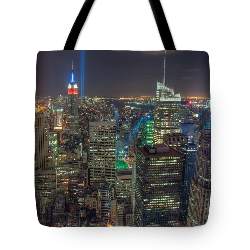 Clarence Holmes Tote Bag featuring the photograph Tribute In Light Iv by Clarence Holmes