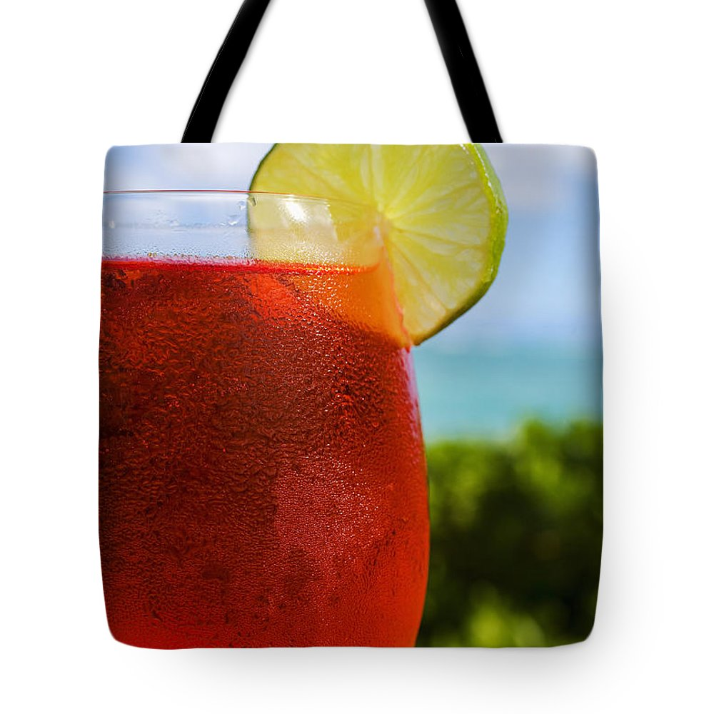 Bar Tote Bag featuring the photograph Tropical Cocktail by Tomas del Amo - Printscapes