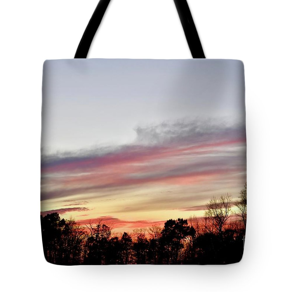Amazing Sunset Tote Bag featuring the photograph True Colors by Jeramey Lende