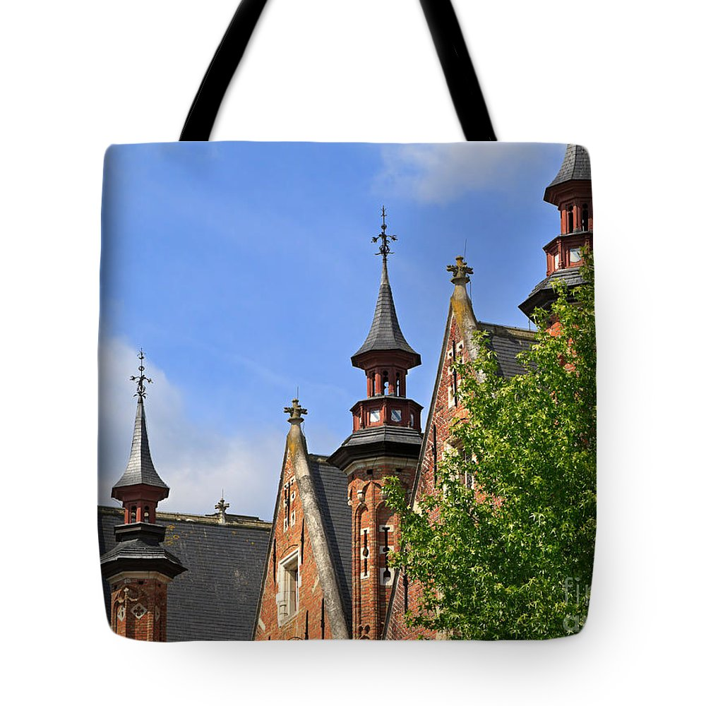 Steenhouwersdijk Tote Bag featuring the photograph Turrets And Roofs Beside Steenhouwersdijk Canal In Bruges by Louise Heusinkveld
