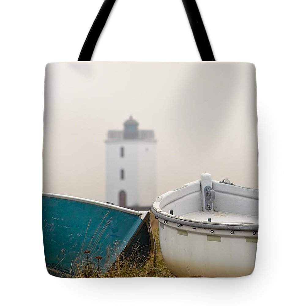 Lighthouse Tote Bag featuring the photograph Two Boats And A Lighthouse by Robert Lacy