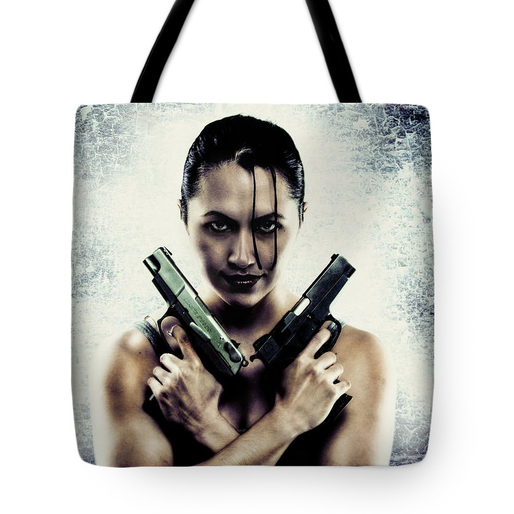 Photograph Tote Bag featuring the photograph Lara Croft by Reynaldo Williams