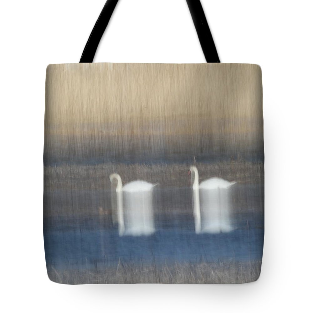 Swans Tote Bag featuring the photograph Two Swans In Movement by Karol Livote