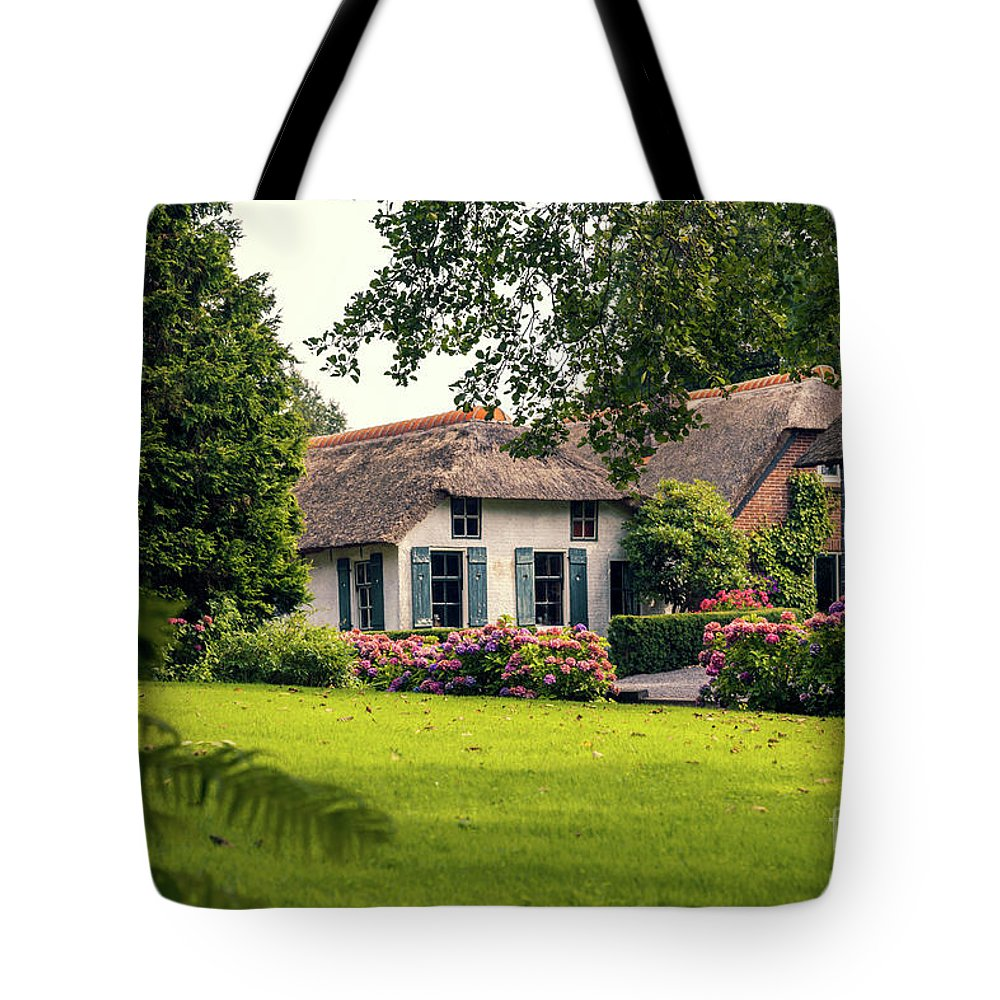 Architecture Tote Bag featuring the photograph typical dutch county side of houses and gardens, Giethoorn by Ariadna De Raadt