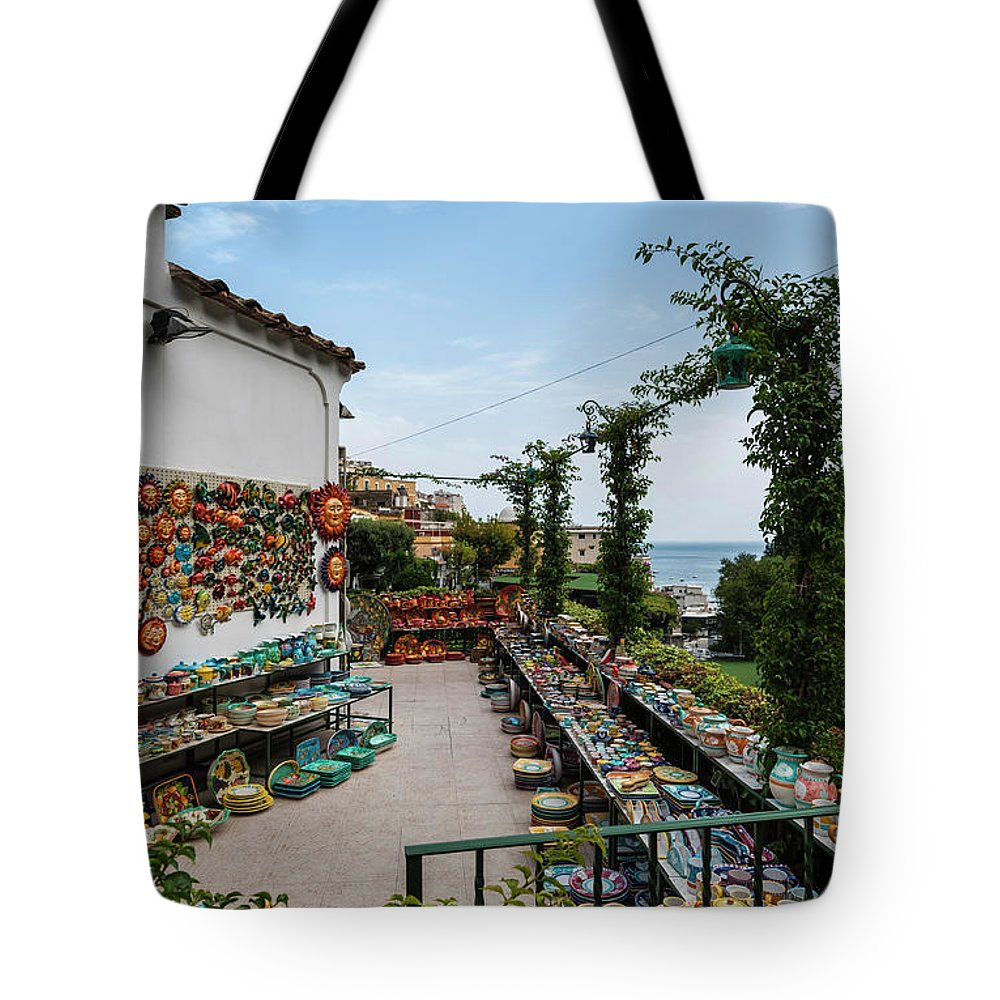 Amalfi Coast Tote Bag featuring the photograph Typical Shop Display Of Ceramics For Sale In Positano, Amalfi Co by Lionel Everett