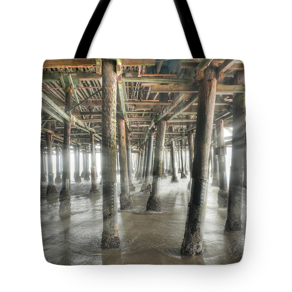 Under The Boardwalk Tote Bag featuring the photograph Under The Boardwalk Into The Light by David Zanzinger