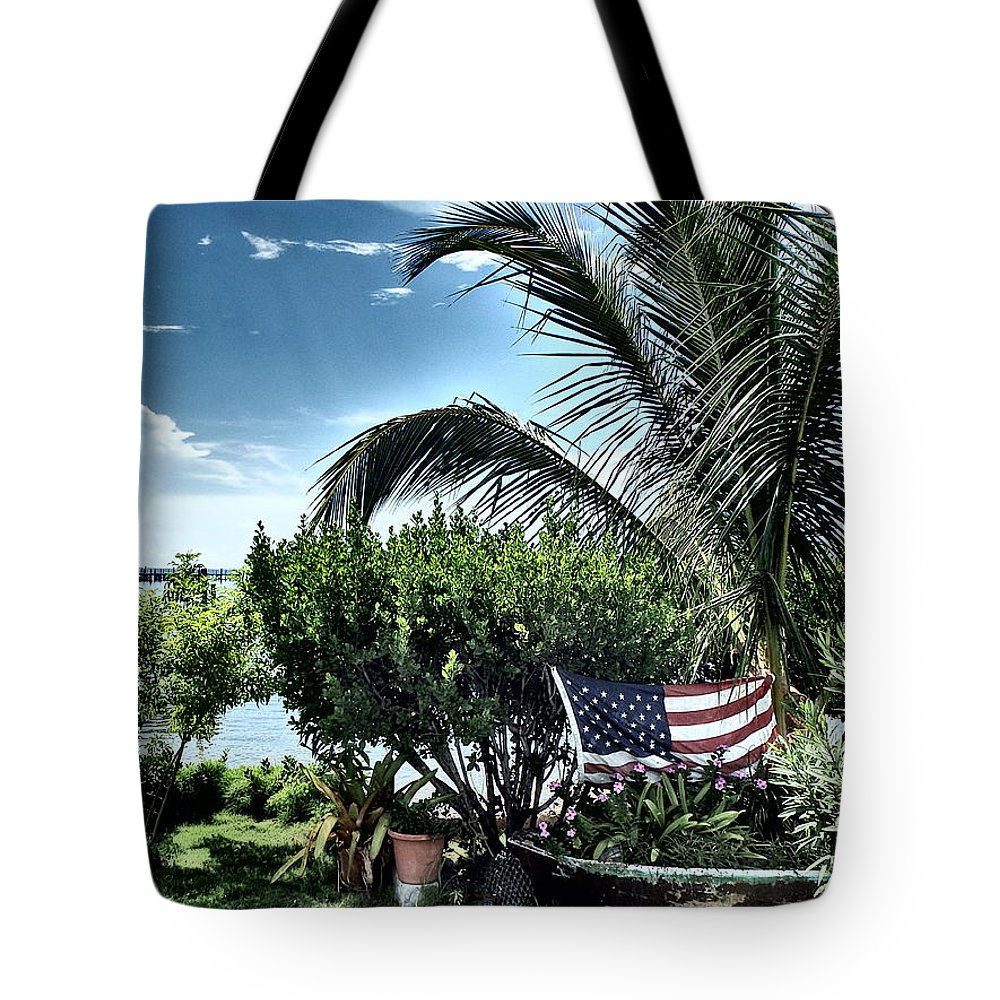 Amerian Flag Tote Bag featuring the photograph US Flag in the Abaco Islands, Bahamas by Cindy Ross