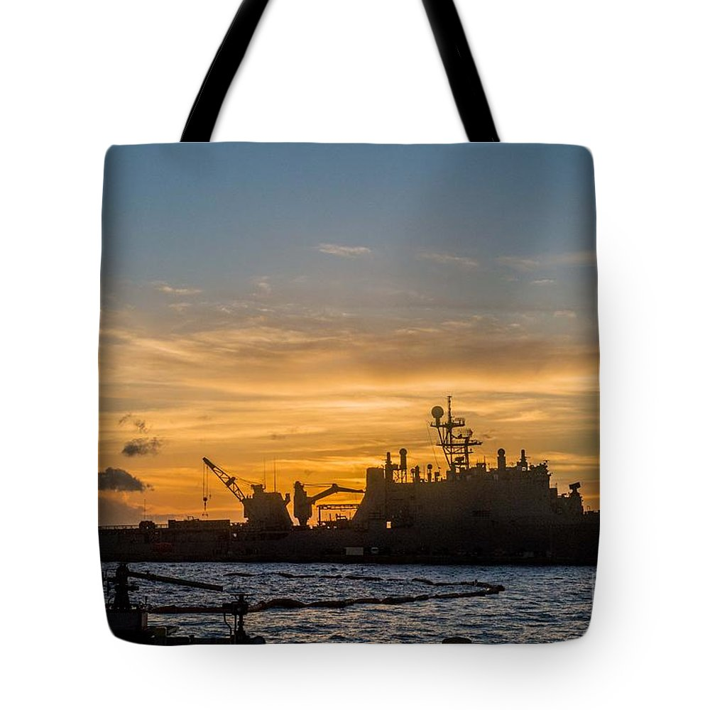 Sailors Tote Bag featuring the painting Uss Germantown At Sunset. by Celestial Images