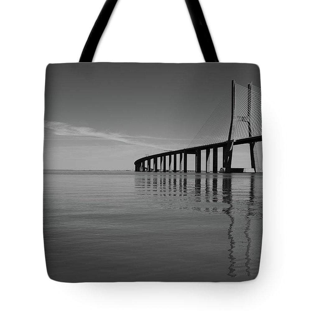 Vasco Da Gama Bridge Tote Bag featuring the photograph Vasco Da Gama Bridge by Marco Oliveira