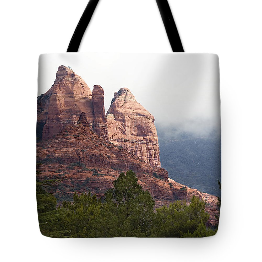 Mountains Tote Bag featuring the photograph Veiled In Clouds by Phyllis Denton