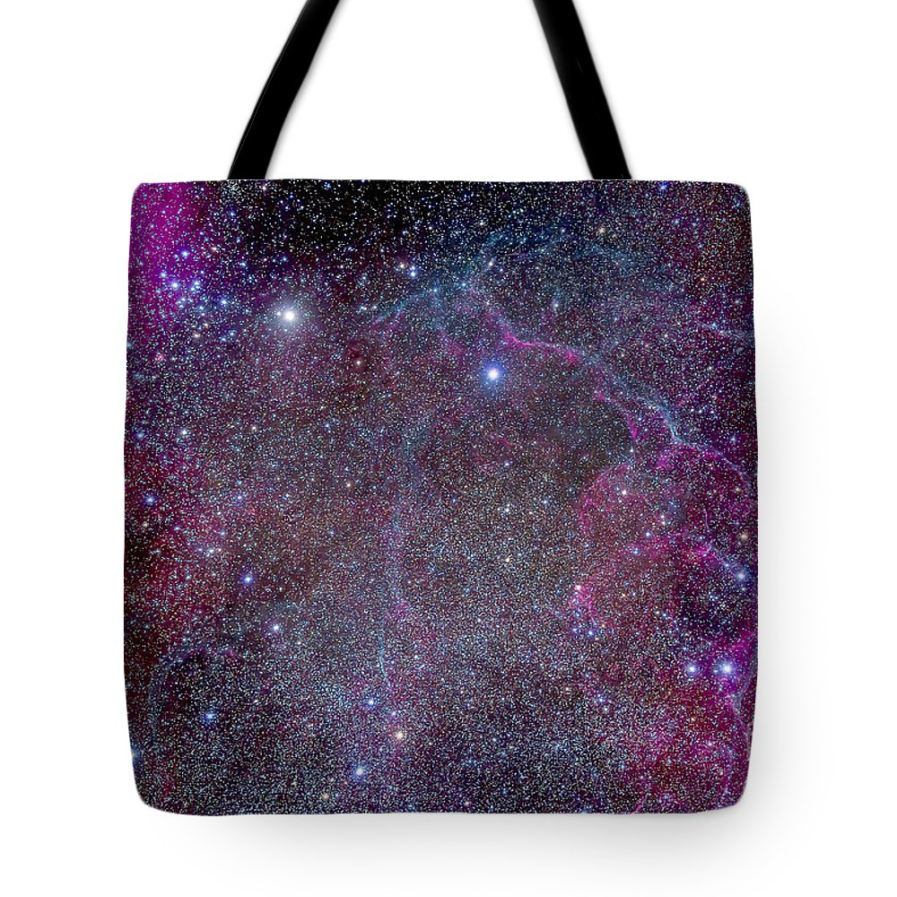 Gum 17 Tote Bag featuring the photograph Vela Supernova Remnant In The Center by Alan Dyer