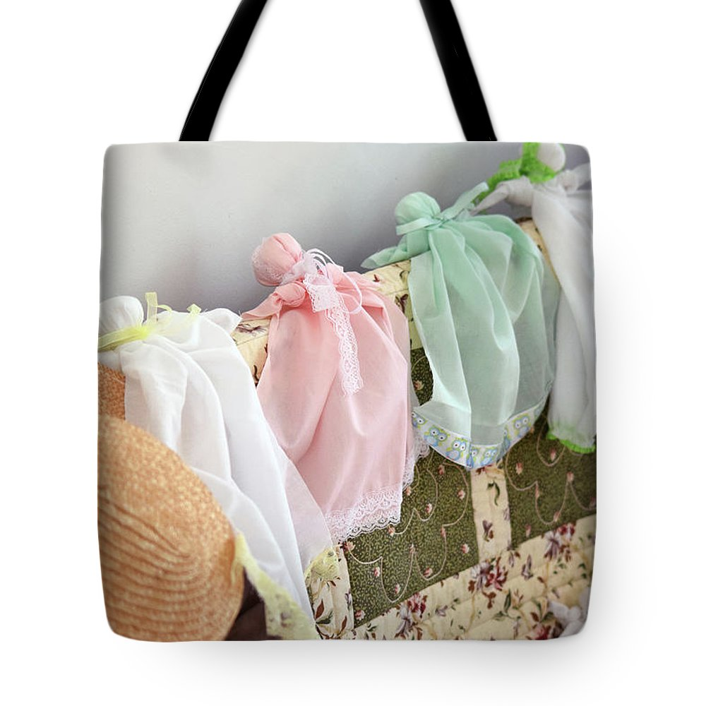 Vintage Tote Bag featuring the photograph Vintage Cloth Dolls by Joseph Rainey