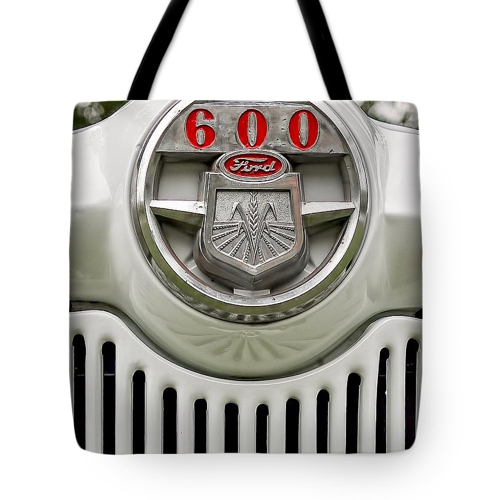 Vintage Tote Bag featuring the photograph Vintage Ford 600 Nameplate Emblem by Edward Fielding