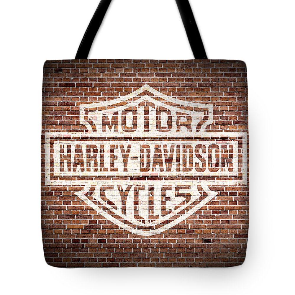 Vintage Tote Bag featuring the mixed media Vintage Harley Davidson Logo Painted On Old Brick Wall by Design Turnpike