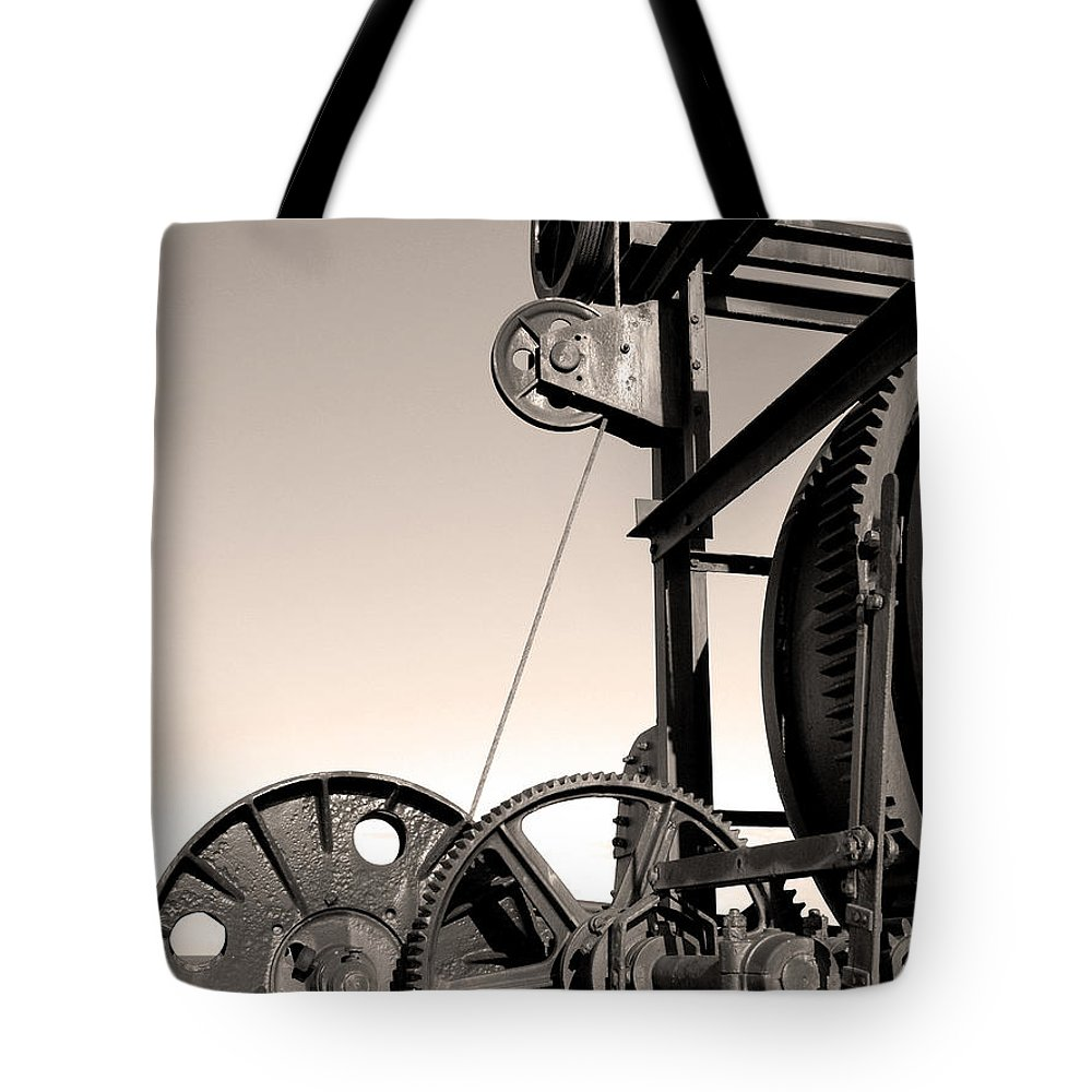 Antique Tote Bag featuring the photograph Vintage Machinery by Gaspar Avila