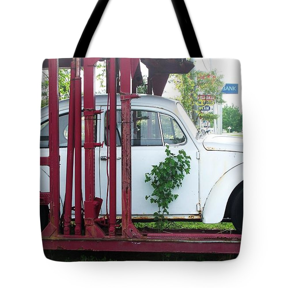 Vw Bug Tote Bag featuring the painting Vw Bug On A Trailer by Eric Schiabor