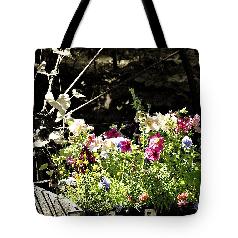 Wagon Wheel Tote Bag featuring the photograph Wagon Wheel And Flowers by Marilyn Hunt